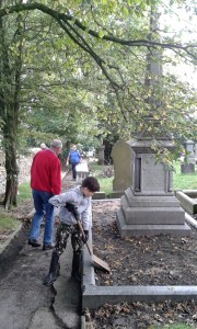 Volunteers tidy the grave of Sir W.P.Hartley